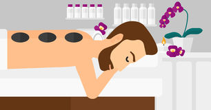 Man getting stone therapy. Stock Image