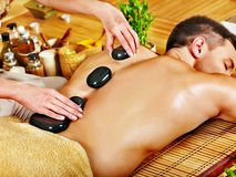Man getting stone therapy massage . Royalty Free Stock Photography