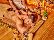 Man getting stone therapy massage Stock Photo