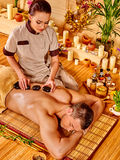 Man getting stone therapy massage Royalty Free Stock Photo