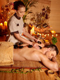 Man getting stone therapy massage Stock Image