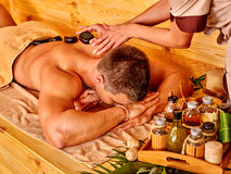 Man getting stone therapy massage Stock Photos