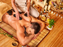 Man getting stone therapy massage Royalty Free Stock Photos