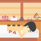 Man getting stone therapy vector illustration. Royalty Free Stock Images