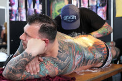 Man getting a tattoo, at a tattoo studio Royalty Free Stock Images