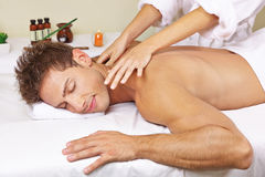 Man getting thai massage in day spa. Relaxed men getting thai massage for his back in a day spa Stock Photo