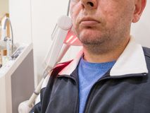 Man getting UV heat treatment at clinic Stock Photos