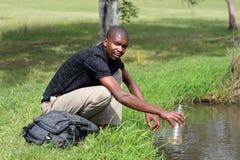 Man getting water Stock Photo