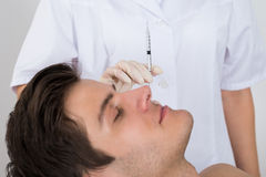 Man Getting Wrinkle Treatment From Doctor Royalty Free Stock Images