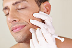 Man getting wrinkle treatment near mouth stock image
