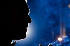 Man gezichtssilhouet bij nacht Stock Afbeelding