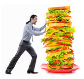 Man and giant sandwich. On white Stock Image