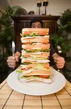 Man and giant sandwich Royalty Free Stock Image