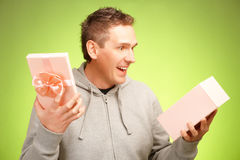 Man with gift. Cheerful man surprised and happy of what's inside his birhday gift box Stock Images