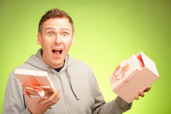 Man with gift. Cheerful man surprised of what's inside his birhday gift box Stock Photos
