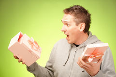 Man with gift. Cheerful man surprised of what's inside his birhday gift box Royalty Free Stock Photography