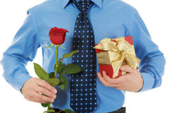 Man with a gift box and a rose Stock Photo