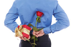 Man with a gift box and a rose Royalty Free Stock Photo