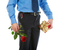 Man with a gift box and a rose Stock Image