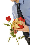 Man with a gift box and a rose Stock Photography