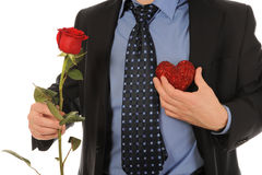 Man with a gift box and a rose Royalty Free Stock Photography