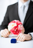 Man with gift box in suit Royalty Free Stock Photo
