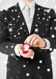 Man with gift box and wedding ring Stock Images