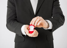 Man with gift box and wedding ring Royalty Free Stock Image