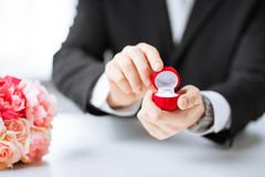Man with gift box and wedding ring Stock Photo