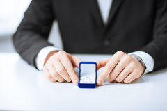 Man with gift box and wedding ring Royalty Free Stock Images