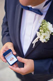 Man with gift box and wedding ring. Royalty Free Stock Images