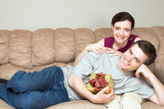 Man With A Gift Box on Woman's Lap on So Stock Images