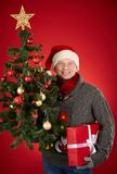 Man with gift and firtree Stock Photo