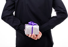Man with a gift in hand, view from the back Stock Photography