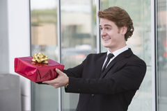 Man with gift in his hand Royalty Free Stock Photo