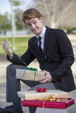 Man with gift in his hand Royalty Free Stock Image