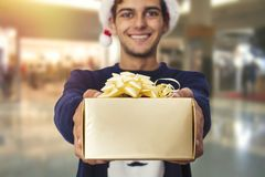 Man with a gift from the mall. Smiling young man with a gift from the mall Royalty Free Stock Image