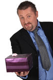 Man with gift package Stock Image