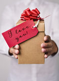 Man with gift with text I love you Stock Photos
