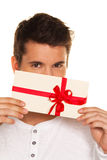 Man with a gift voucher in hand. Man holding a gift voucher in his hand. Shopping voucher Stock Images