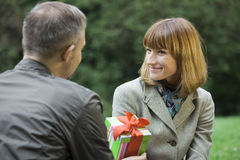 Man with gift for woman Royalty Free Stock Photos