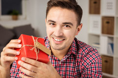 Man with gift Stock Image