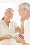 Man Gifting Woman At Home Stock Images