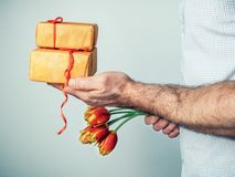 Man with gifts and flowers royalty free stock images