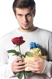 Man with gifts and rose. Young man with gifts and rose Stock Image