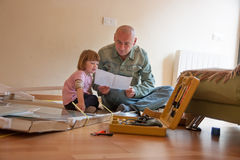 Man and  girl assembling    table Royalty Free Stock Photo