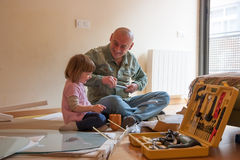 Man and  girl assembling  table Stock Photos