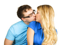 Man and girl in blue shirt kissing isolated Stock Images