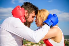 Man and girl cuddle happy after fight. Couple in love boxing gloves hug sky background. Quarrel and put up concept. Family life happiness. Reconciliation and royalty free stock image