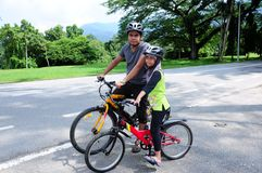 Man and young Girl Cycling Stock Images